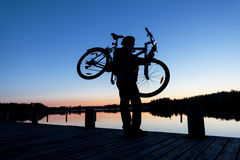 Silhouette of a Cyclist on the Sunset Sky Stock Photography