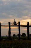 Silhouette of a cyclist on U Bein Bridge at sunset Royalty Free Stock Images