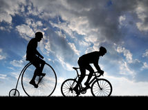 Silhouette cyclists on bicycles Stock Image