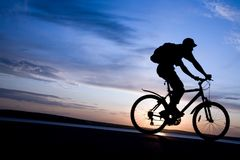 Silhouette of cyclists in motion Stock Images