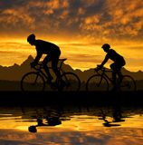Silhouette of the cyclists Stock Photo
