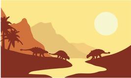 Silhouette d'ankylosaurus au matin Photos stock
