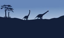Silhouette d'argentinosaurus sur la colline Photographie stock libre de droits