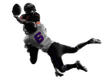 Silhouette d'attirail de deux joueurs de football américain Photographie stock libre de droits