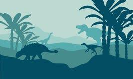 Silhouette d'eoraptor et d'ankylosaurus Photographie stock libre de droits