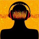 Silhouette d'homme avec des écouteurs et des notes de musique Photo stock