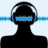 Silhouette d'homme avec l'écouteur et les ondes sonores Image libre de droits