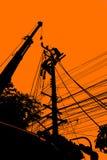 Silhouette d'installation de l'électricité et de maintenanc électrique Image libre de droits