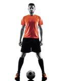 Silhouette d'isolement par homme de footballeur Image stock