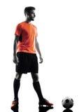 Silhouette d'isolement par homme de footballeur Images stock