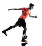 Silhouette d'isolement par homme de footballeur Photographie stock libre de droits