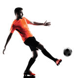 Silhouette d'isolement par homme de footballeur Photo stock