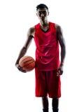 Silhouette d'isolement par joueur de basket d'homme Photo libre de droits