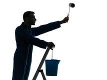 Silhouette d'ouvrier de peintre de maison d'homme Photos libres de droits