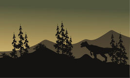 Silhouette d'un allosaurus en collines Photo stock