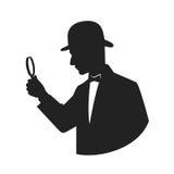 Silhouette d'un détective avec la loupe Photographie stock