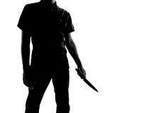 Silhouette d'un homme avec le couteau Photos libres de droits