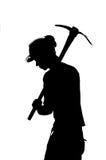 Silhouette d'un mineur avec le casque Photographie stock libre de droits