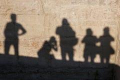 Silhouette d'un photographe dans une ville antique Photographie stock