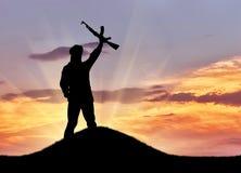 Silhouette d'un terroriste photos stock