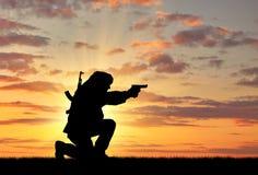 Silhouette d'un terroriste photos libres de droits