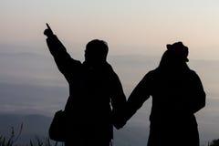 Silhouette d'un voyage de couples et d'amour Image libre de droits