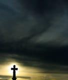 Silhouette d'une croix Photo stock