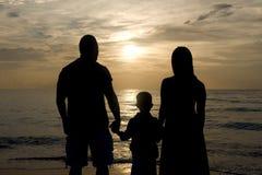 Silhouette d'une famille Photographie stock libre de droits
