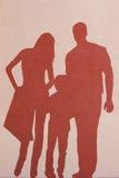 Silhouette d'une famille photos stock