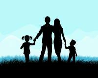 Silhouette d'une famille Photo stock