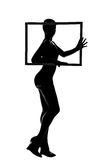 Silhouette d'une fille avec le cadre photo stock