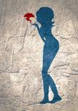Silhouette d'une fille qui envoie un baiser d'air Images stock