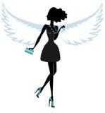 Silhouette d'une jeune femme avec Angel Wings Photo stock