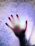 Silhouette d'une main photos stock
