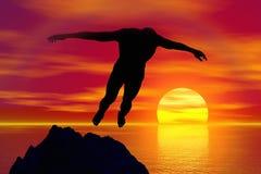 Silhouette d'une plongée d'homme sur le coucher du soleil Image libre de droits