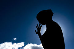 Silhouette d'une statue Photos stock