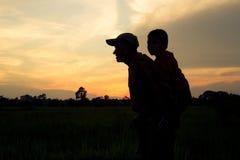 Silhouette, Dad took his son piggyback stock photos