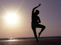 Silhouette Dance Pose. A beautiful silhouette Indian dance pose on the beach Stock Photography