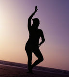 Silhouette Dance Pose. A beautiful silhouette Indian dance pose on the beach Royalty Free Stock Photography