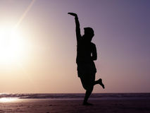 Silhouette Dance Pose. A beautiful silhouette Indian dance pose on the beach Stock Photos