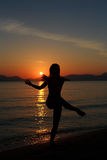 Silhouette of a dancer in the beach Stock Image