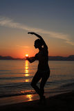 Silhouette of a dancer in the beach Stock Photos