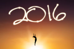 Silhouette dancer celebrate new year of 2016. Silhouette of female dancer celebrating new year and jumping on the sky under numbers 2016 Stock Images