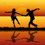 Silhouette of dancers Stock Photography