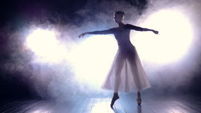 Silhouette of the dancing ballerina. Slowmotion. HD.