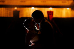 Silhouette of dancing bride and groom Royalty Free Stock Photos