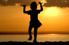 Silhouette of dancing child. Silhouette of dancing girl on sundown Royalty Free Stock Photos