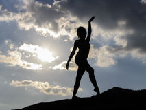 Silhouette of a dancing girl. Royalty Free Stock Image