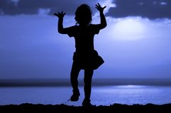 Silhouette of dancing girl on moon night Royalty Free Stock Images