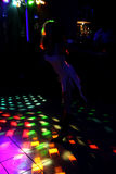 Silhouette of a dancing girl in a white dress in the night club Royalty Free Stock Photos